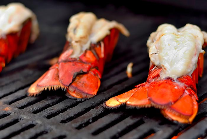 Juicy Lobster tails on a grill